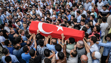 People carry a coffin covered with Turkish national flag of suicide attack victim Hamidullah Safar on June 30, 2016 in Istanbul during his funeral two days after a suicide bombing and gun attack targeted Istanbul's airport, killing at least 36 people.  The death toll from the triple suicide bombing and gun attack that occurred on June 28, 2016 at Istanbul's Ataturk airport has risen to 43 including 19 foreigners. The government has pointed the finger of blame at the Islamic State group and Turkish police rounded up 13 suspected IS jihadists in raids at 16 different locations across Istanbul on June 30.  / AFP PHOTO / OZAN KOSE
