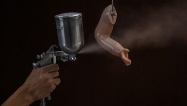A worker paints a hand of a mannequin at a factory in Ampang, in the suburbs of Kuala Lumpur on October 17, 2016. The factory, which produces five to ten mannequins a day has been in operation for 25 years, with most of the plastic dolls being used in Malaysian malls and some exported overseas. / AFP PHOTO / MOHD RASFAN