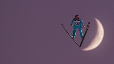 Vincent Descombes Sevoie of France competes in front of the moon during the FIS Ski Jumping World Cup on December 4, 2016 in Klingenthal, eastern Germany.  Domen Prevc of Slovenia won the event ahead of Daniel Andre Tande of Norway (2nd) and Stefan Kraft of Austria (3rd).  / AFP PHOTO / Robert MICHAEL