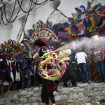 A member of the Santo Tomas brotherhood takes part in the procession in honour of the saint in Chichicastenango municipality, Quiche department, 150 kilometres west of Guatemala City on December 21, 2016. / AFP PHOTO / JOHAN ORDONEZ