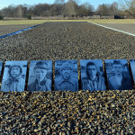 Photographs of shot Soviet solders are seen on the grounds of the Sachsenhausen memorial of a former Nazi concentration camp in Oranienburg near Berlin, on January 27, 2017, during the International Holocaust Remembrance Day. / AFP PHOTO / dpa / Maurizio Gambarini / Germany OUT