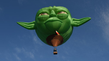 A hot air ballon in the likeness of Star Wars film character Yoda takes flight during the annual International Hot Air Balloon Festival at the former Clark US Air Force base in Pampanga province, north of Manila on February 9, 2017.  Some 29 balloon enthusiasts from around the globe are participating in the event which runs February 9 to 12. / AFP PHOTO / TED ALJIBE