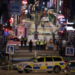 "Police work at the scene in to the night after a truck slammed into a crowd of people outside a busy department store in central Stockholm, causing ""deaths"" in what the prime minister described as a ""terror attack"" on April 7, 2017.  / AFP PHOTO / Odd ANDERSEN"